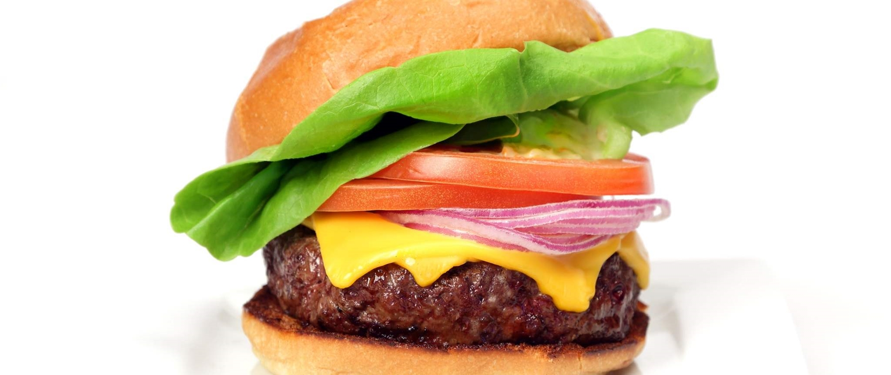 Cheeseburger With Lettuce, Tomato And Onions With White Background